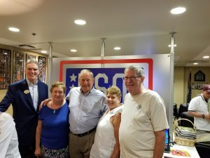 Some of USO's Volunteers and sponsors at an event.