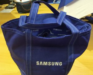 Blue Samsung tote bag.